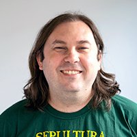 Male Back-end developer with long hair